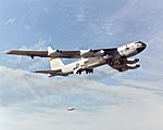 X-43A and its booster rocket tucked under B-52B wing (4857948029).jpg
