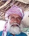 Yameen Ghamgheen Babar poet in front of his hut type house, Johi, Dadu District Sindh Pakistan.jpg