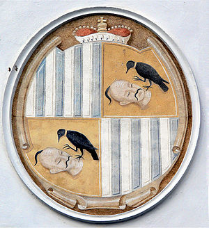 Karel Schwarzenberg - Coat of arms of the House of Schwarzenberg: A raven gnawing at Turkish heads.