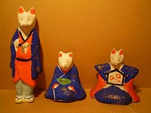 Imado doll - Imado dolls in the shape of kitsune wearing clothes