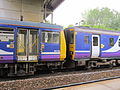142095 coupled to 156421 at Wavertree Technology Park railway station.JPG