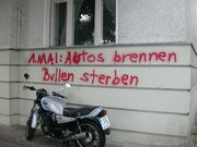"""May Day graffiti in Kreuzberg. The text reads, """"May 1st: Cars burn, cops die""""."""