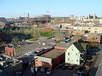 Stadium Village, Minneapolis - Stadium Village, with the new TCF Bank Stadium rising in the background and the trapezoidal McNamara Alumni Center standing where part of the old Memorial Stadium once stood.