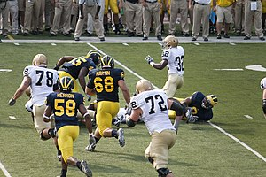 Obi Ezeh - Ezeh lines up Theo Riddick during 2009 Michigan-Notre Dame rivalry game.