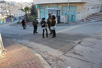 Israeli occupation of the West Bank - Palestinian girls having their school bags searched by Israeli soldiers in Tel Rumeida, Hebron