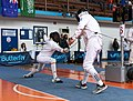 2nd Leonidas Pirgos Fencing Tournament. Lunge and touch for the fencer on the left.jpg