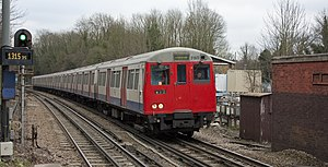 Amersham (local) bound Metropolitan line train approaching Chorleywood, Hertfordshire.