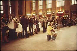 AMTRAK PASSENGERS LINED UP WAITING FOR A FRIDAY AFTERNOON TRAIN AT THE 30TH STREET STATION IN PHILADELPHIA. IT IS ONE... - NARA - 556687.jpg