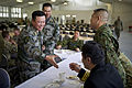 A Chinese People's Liberation Army senior officer with the Beijing Military Region, left, shakes hands with senior Japan Ground Self-Defense Force officials during a luncheon for senior leaders at the 2012 120513-F-MQ656-249.jpg