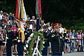 A U.S. Army bugler, right foreground, plays taps during a wreath-laying ceremony at the Tomb of the Unknowns at Arlington National Cemetery, Va., June 6, 2013 130606-A-AO884-257.jpg