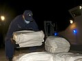 A U.S. Coast Guardsman stationed aboard the coastal patrol boat USCGC Hawk (WPB 87355) offloads more than $12 million of cocaine at Coast Guard Sector St. Petersburg, Fla., Nov. 13, 2013, during Operation 131113-G-XO423-004.jpg