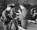 A WAAF section officer and her assistant issue new items of flying kit to aircrew at an RAF bomber station, August 1944. CH13713.jpg