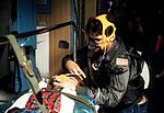 "A member of the 2nd Aeromedical Evacuation Squadron helps a ""patient"" with his oxygen mask during a C-9 Nightingale aircraft egress training exercise DF-ST-85-12274.jpg"