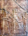 A procession of high-ranking Assyrian officials and dignitaries with their swords. From the South-West Palace, Nineveh, Iraq. 7th century BCE. Pergamon Museum, Berlin.jpg