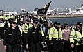A small number of right wing anti-immigration protesters, escorted by police, take an afternoon stroll along Dover's seafront. (27039383230).jpg