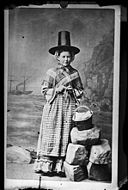 A woman in national dress and knitting (copy) NLW3362579.jpg