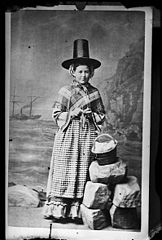 A woman in national dress and knitting (copy)