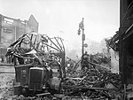 A wrecked bus stands among a scene of devastation in the centre of Coventry after the major Luftwaffe air raid on the night of 14-15 November 1940. H5593.jpg