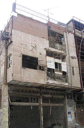 Battle-damaged buildings in the Iranian city of Abadan, seen in 2007 Abadan ruin.jpg