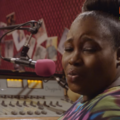 Abimbola Craig in E1S1 of Skinny Girl in Transit March 2015.png