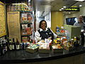 Acela Express cafe car with attendant at counter.jpg