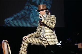 Adam Cheng - Adam Cheng singing at a Singapore concert