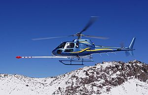 Aeromagnetic survey - Eurocopter AS350 geophysical survey helicopter equipped with an aeromagnetic survey system.