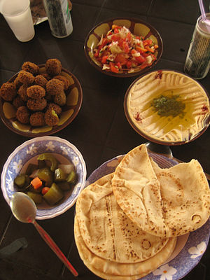 Jordanian cuisine - Hummus, falafel, salad, pickles and khubz (pita). A typical Jordanian breakfast, Ajloun, 2009.
