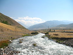 The Ak-Suu River flowing from the Narzan valley into the south end of Jardy-Suu village.