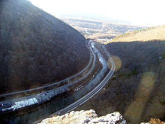 Wills Mountain - The Cumberland Narrows west of Cumberland, Maryland, the water gap along Wills Creek through which the National Road crosses between Haystack Mountain (left) and Wills Mountain (right).  This easy passage through the rugged Wills Mountain Anticline is now used by the Western Maryland Scenic Railroad (left), Alternate U.S. 40 (center, left of the creek), and the CSX Railroad (right).