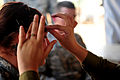 An Israeli soldier applies makeup to simulate wounds on a U.S. Soldier for her role in a medical exercise for Austere Challenge 2012 in Beit Ezra, Israel 121022-F-QW942-021.jpg