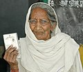 An old woman (86 years) displaying her voter identity cards at a polling booth of Pure Chirai in Soalan, Rae Bareli, during the 2nd Phase of General Election-2009 on April 23, 2009.jpg