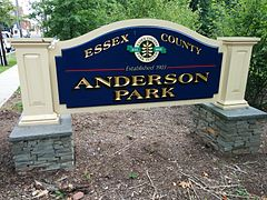 "Anderson Park Sign showing Essex County and seal of Essex County Park System (Established 1895) above the Park Name along with the text ""Established 1903"""