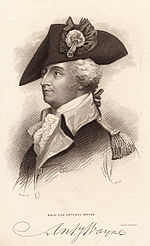 Black and white print shows a man in a large tricorne hat with a large cockade. He wears a dark military coat with lighter lapels and a white ruffled shirt at his throat.