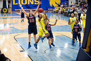 Arlington Baptist College - The Arlington Baptist women's basketball team in action against the Texas A&M–Commerce Lions in 2015