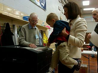 Kelly Ayotte - Kelly Ayotte's son, Jake, age 2, helps her cast her ballot
