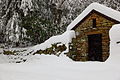 Babcock-state-park-winter-rock-shed-snow-falling-pub - West Virginia - ForestWander.jpg
