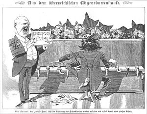 "Count Kasimir Felix Badeni - Count Badeni the ""curious gentleman"", revives the invention of the cat organ and thus achieves a great success."" Caricature published in Kladderadatsch (1897)"
