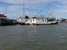 Barges in Suriname river II.JPG