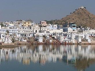 Brahma Temple, Pushkar - Pilgrims bathing in Pushkar Lake with Savitri temple in the background