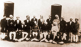 Bhagat Singh - In this historical photograph of students and staff of National College, Lahore, Singh can be seen standing fourth from the right.