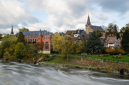 """View from the Ruhr Bridge (""""Ruhrbrücke"""") on the historic center of Essen Kettwig with rebuilt waterside palace (""""Uferpalais"""")"""
