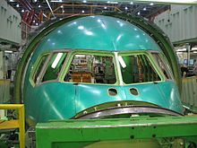 Close up view of a green Section 41, the nose section of a 767. Installation is not yet complete for the window panes.