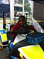 Boy on police bike (9798827535).jpg