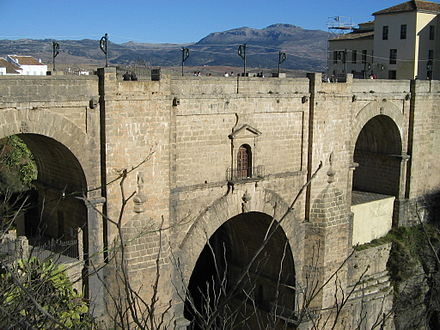 The Puente Nuevo bridge, Ronda. Both Nationalists and Republicans are claimed to have thrown prisoners from the bridge to their deaths in the canyon. Brigde at Ronda, Spain.jpg