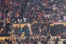 "Photograph of Bruno Mars and The Hooligans performing ""Uptown Funk"" at the Super Bowl 50 halftime show"