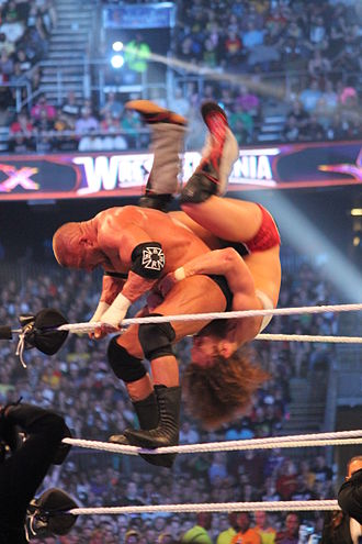 Powerbomb - Daniel Bryan performs a sunset flip superbomb to Triple H at WrestleMania XXX.