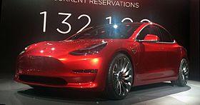 Candy Red Tesla Model 3 trimmed 2.jpg