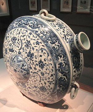 Leather-hard - Canteen, China, Jiangxi Province, 15th century, porcelain with cobalt under colorless glaze. As with nearly all Chinese blue and white porcelain, this was painted when leather-hard, and probably the spout and rings were added.