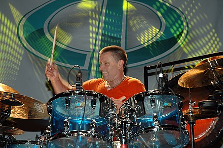 Carl Palmer with rim-mounted tom mics Carl Palmer.jpg